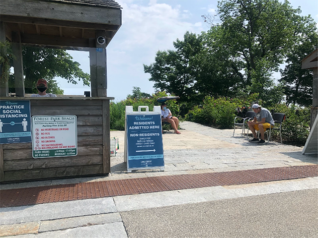A sign at the Forest Park beach entrance, denoting a residents' entrance