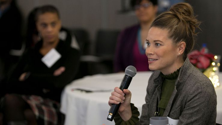 A member of the Emerging Leaders Program asks a question during an event