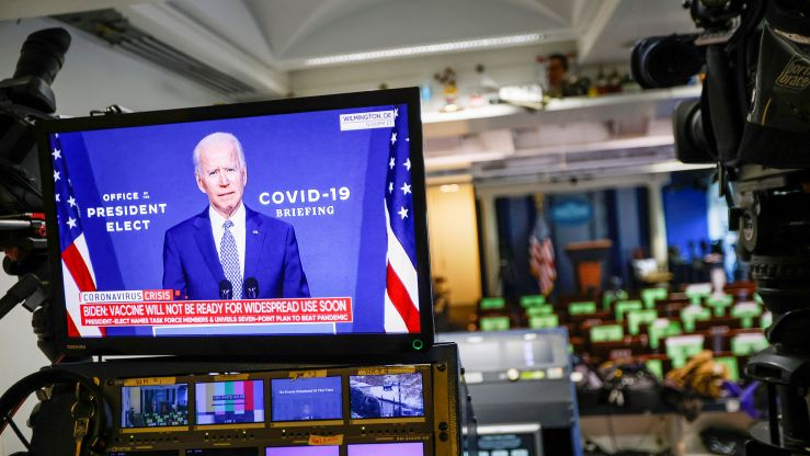 U.S. President-elect Joe Biden is seen making remarks on his plan to fight COVID-19 on a television monitor from the White House Briefing Room, in Washington