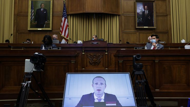 Mark Zuckerberg appears on a video feed testifying before Congress.