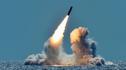An unarmed Trident II D5 missile is test-launched from the ballistic missile submarine USS Nebraska