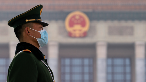 A guard outside the People Hall in Beijing.