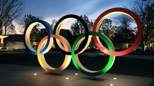 Illuminated Olympic rings are displayed before the new national stadium