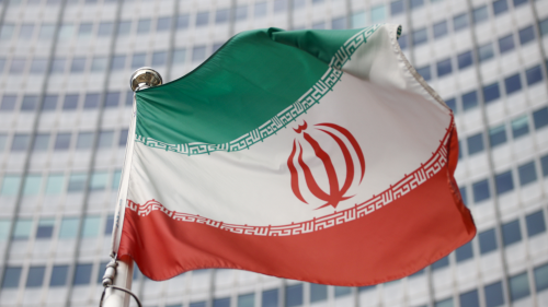 The Iranian flag waves in front of the International Atomic Energy Agency (IAEA) headquarters